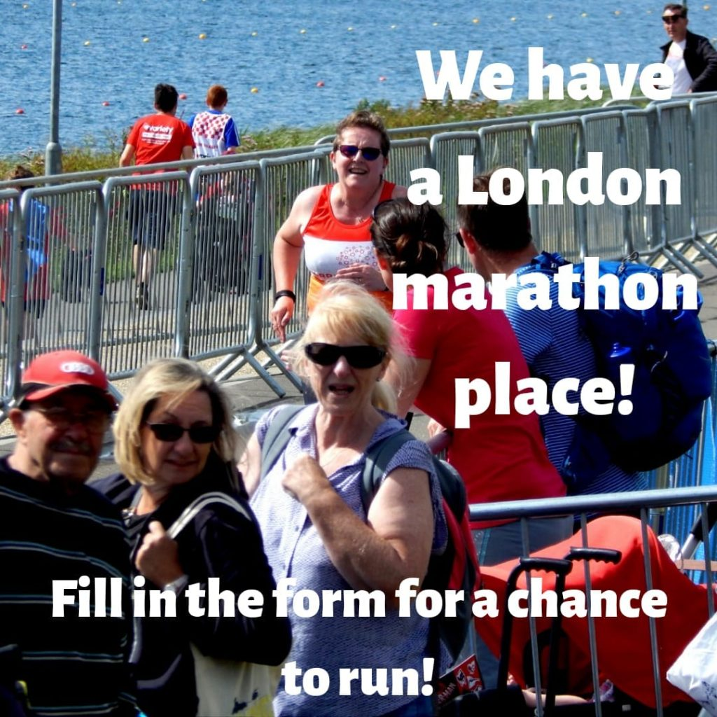 """photo of a sporting event, there are several people in the foreground at barriers in the centre of the image there is a woman in a CRPS UK branded running vest Text over the image reads """"We have a London marathon place! Fill in the form for your chance to run"""""""